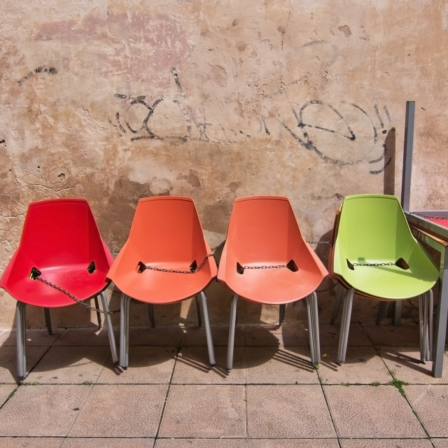 """""""Four colorful plastic chairs"""" stock image"""