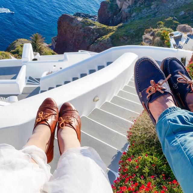 """Couples legs enjoying summer day at Santorini island"" stock image"