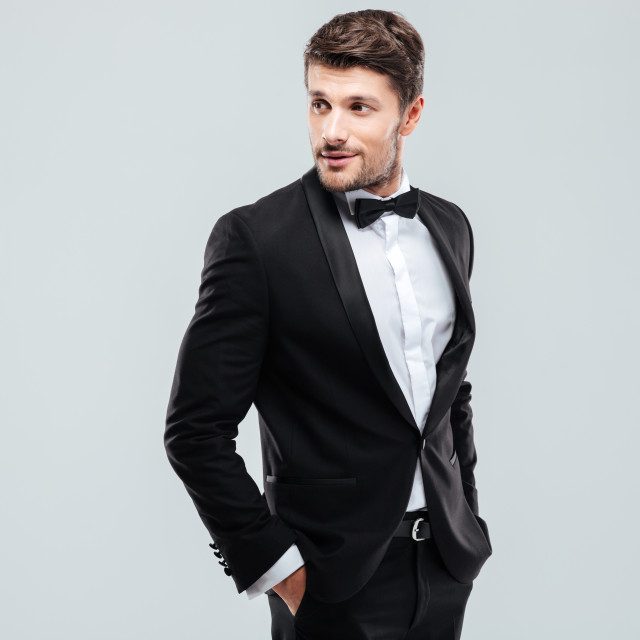 """""""Attractive young man in tuxedo and bowtie"""" stock image"""