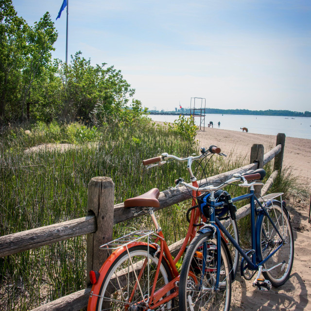 """Bicycles on the beach"" stock image"