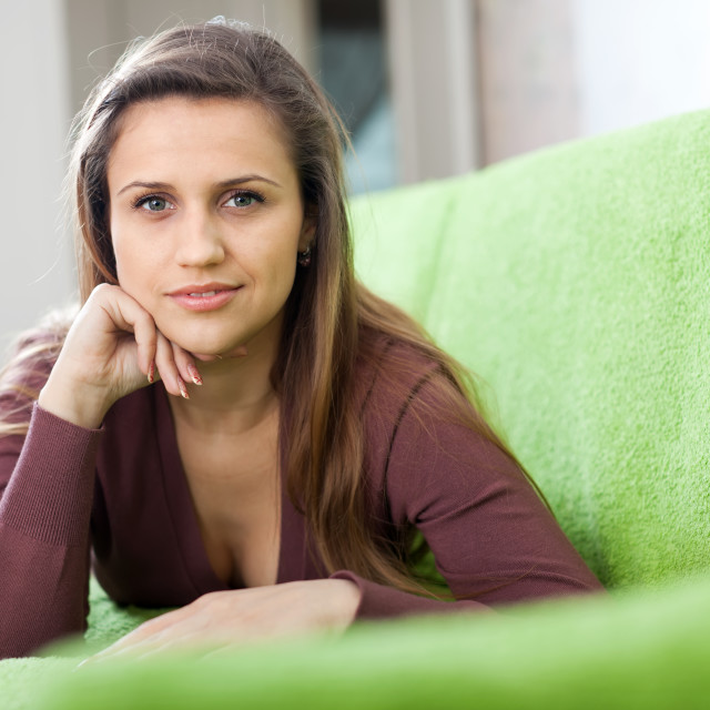 """""""Portrait of tranquil woman in home"""" stock image"""