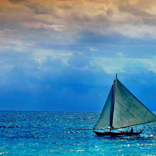 """Solo Sailing on a Tranquil Boracay Afternoon"" stock image"