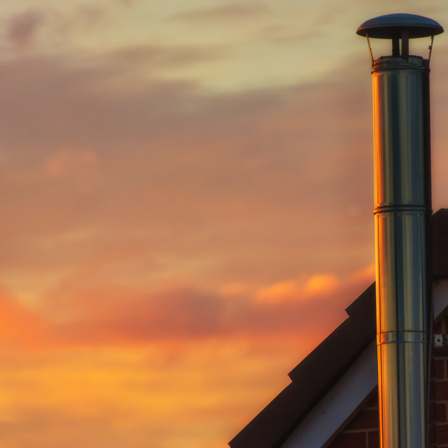 """Silver Chimney against Sunset"" stock image"