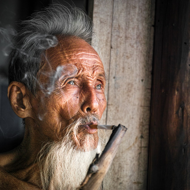 """A cloud of smoke slides along old face"" stock image"