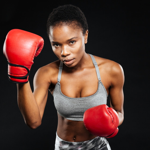 """Fitness woman in booxing gloves on black background"" stock image"