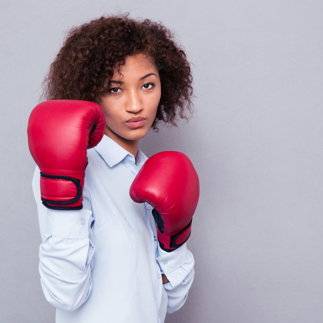 """Afro american woman in boxing gloves"" stock image"