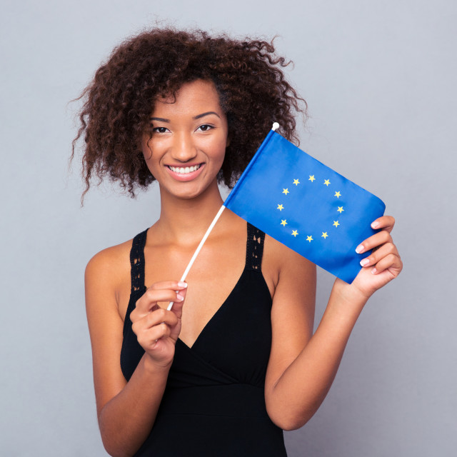 """""""Afro american woman holding Euro flag"""" stock image"""