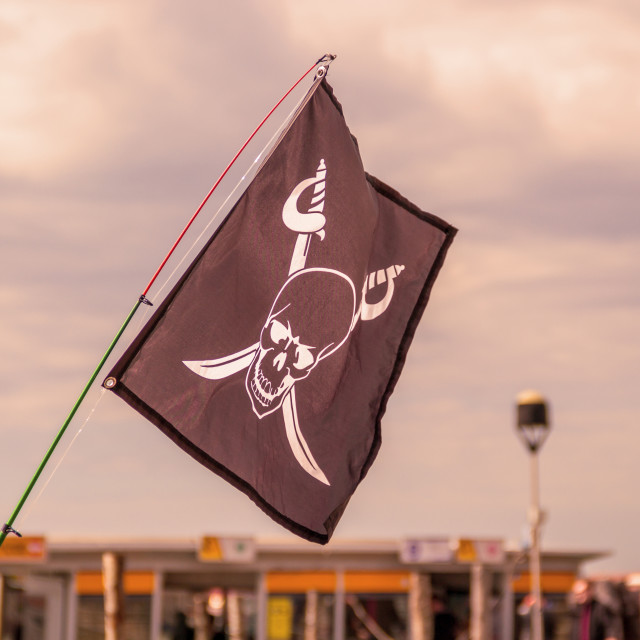 """waving pirate flag jolly roger"" stock image"