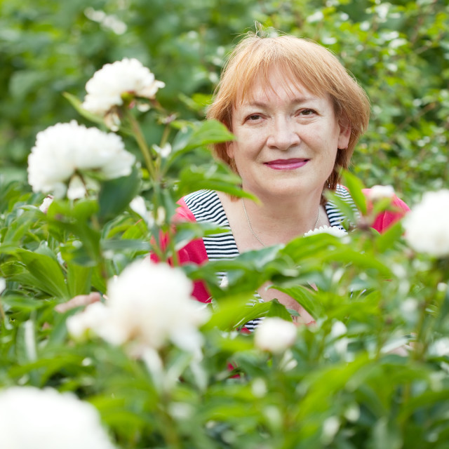 """""""mature woman with flowers"""" stock image"""