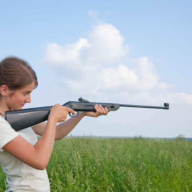 """""""Girl with air rifle"""" stock image"""