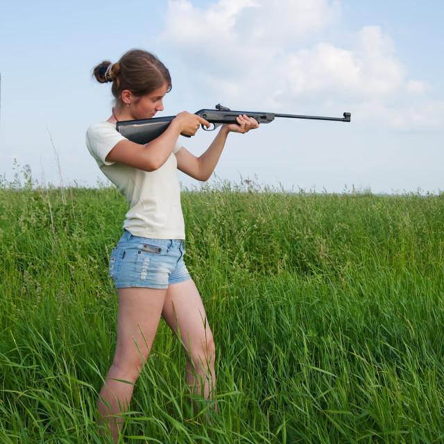 """aiming girl"" stock image"