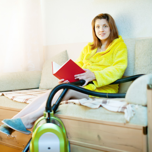 """woman reposes from household chores"" stock image"