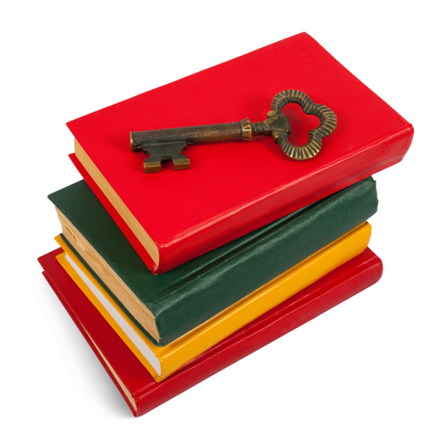 """key placed on pile of books"" stock image"