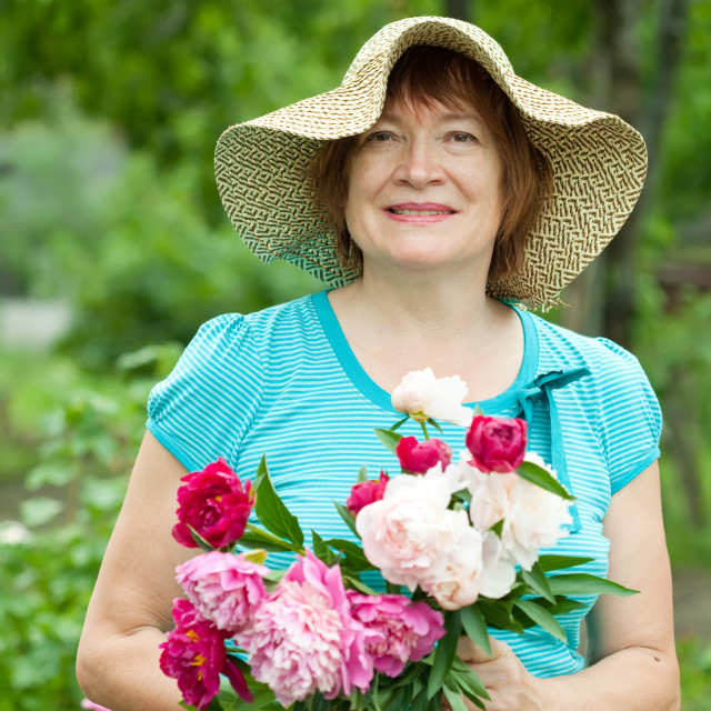 """""""Happy mature woman with bouquet"""" stock image"""