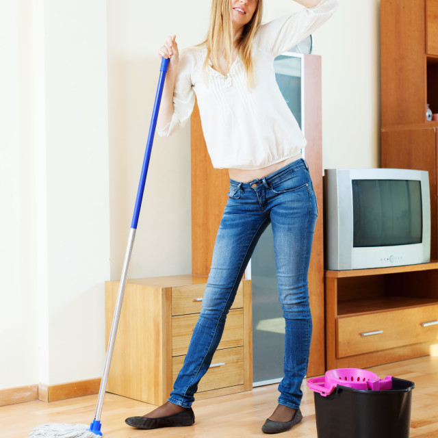 """""""fatigue long-haired girl washing parquet floor"""" stock image"""