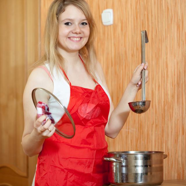 """Happy woman with saucepan"" stock image"