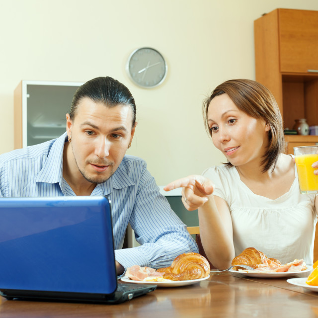 """""""couple looking e-mail during breakfast"""" stock image"""