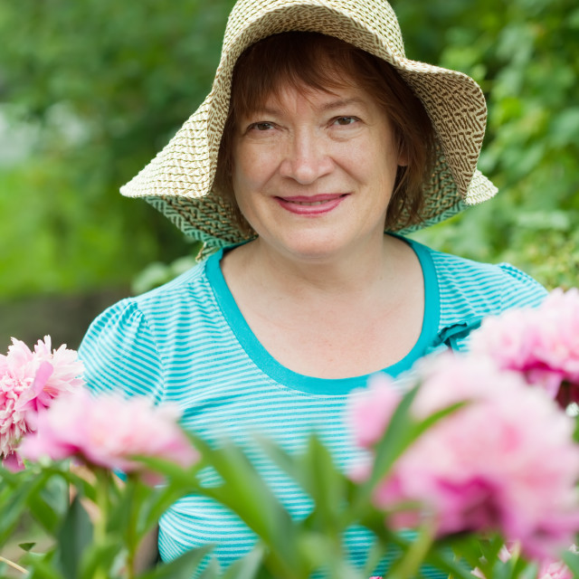 """""""Mature woman in peony plant"""" stock image"""