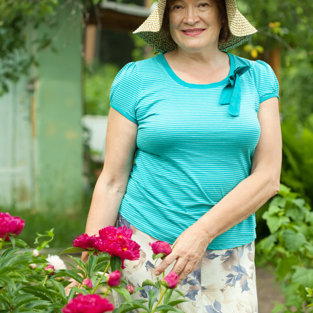 """""""woman in peony plant"""" stock image"""