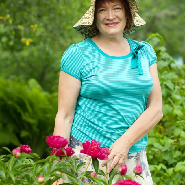 """Smiling mature woman at garden"" stock image"
