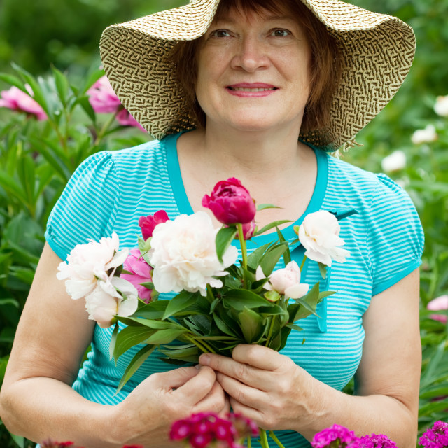 """""""Happy mature woman with flowers"""" stock image"""