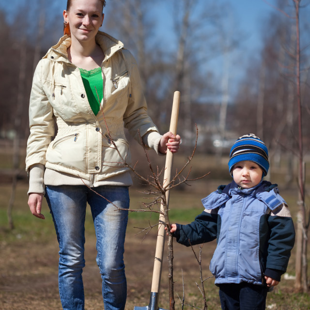 """""""woman with boy planting tree"""" stock image"""
