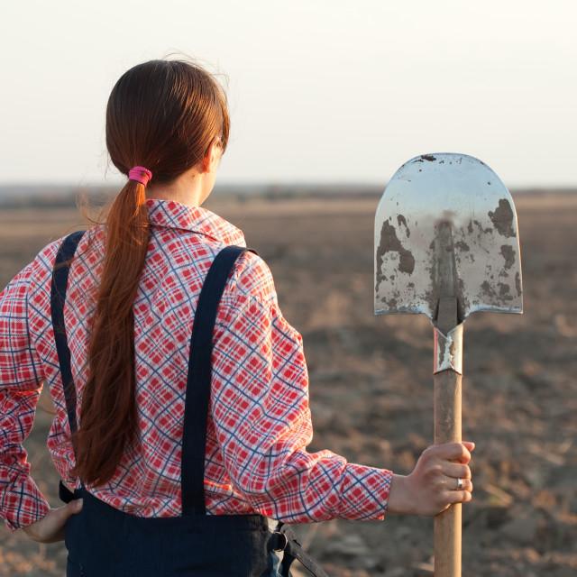 """""""farmer in plowed field"""" stock image"""