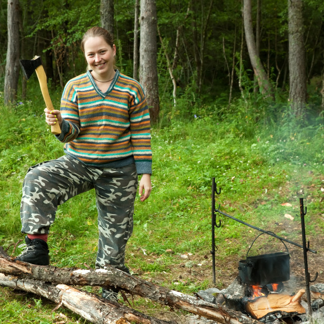 """tourist with axe making firewoods"" stock image"