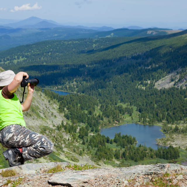 """""""Nature photographer taking pictures the mountains"""" stock image"""