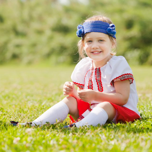 """""""Smiling child in russian folk clothes"""" stock image"""