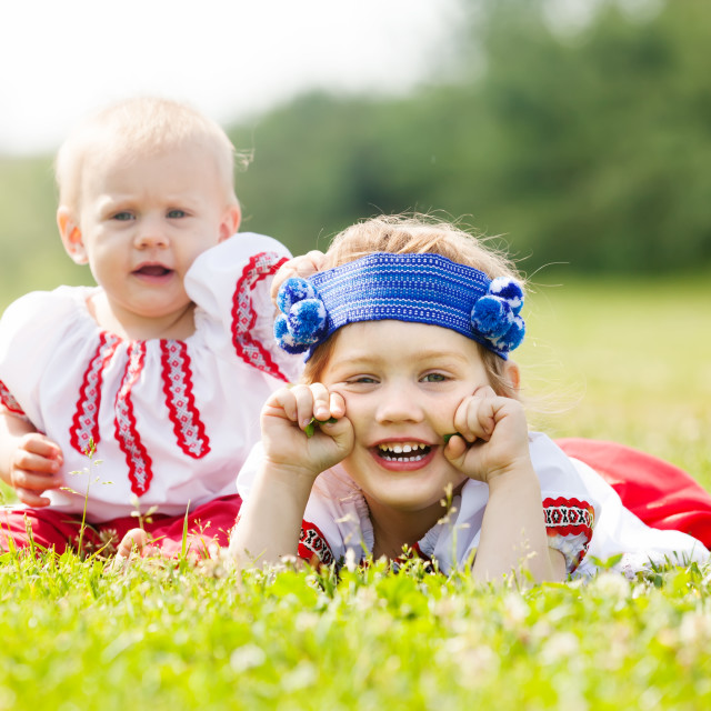 """""""Two children in traditional clothes"""" stock image"""