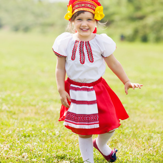 """""""Happy girl in folk clothes"""" stock image"""