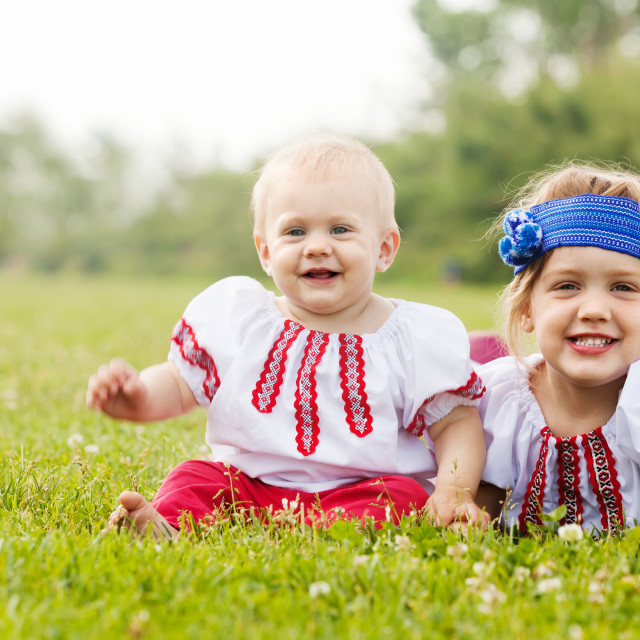 """""""children in russian folk clothes on grass"""" stock image"""