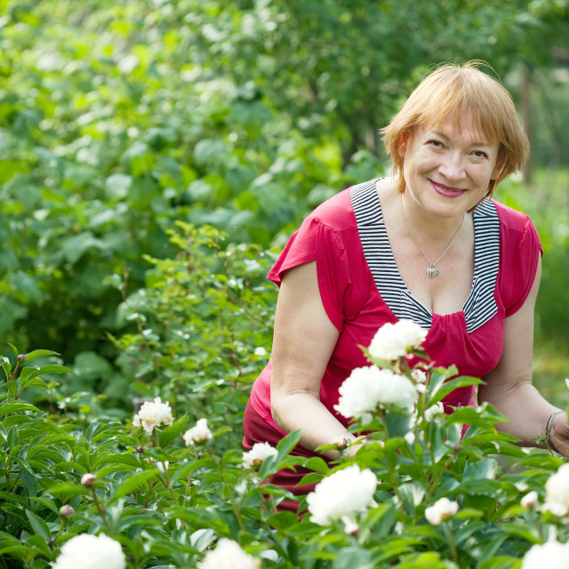 """""""Happy mature woman in peony plant"""" stock image"""