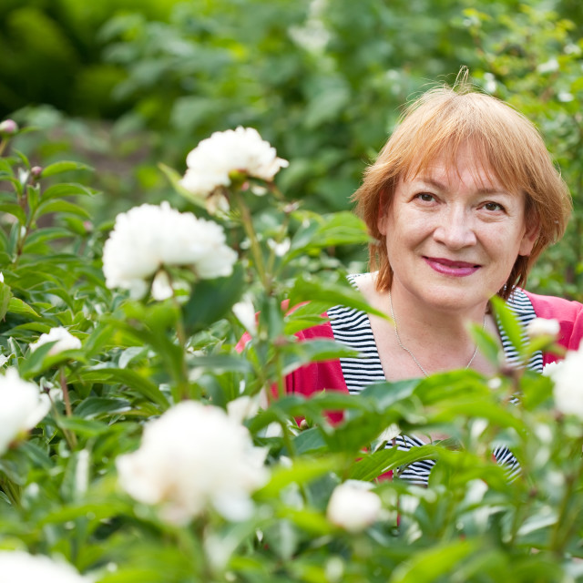 """""""mature woman in pion plant"""" stock image"""
