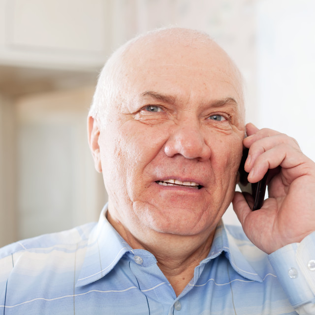 """""""handsome mature man speaking by phone"""" stock image"""