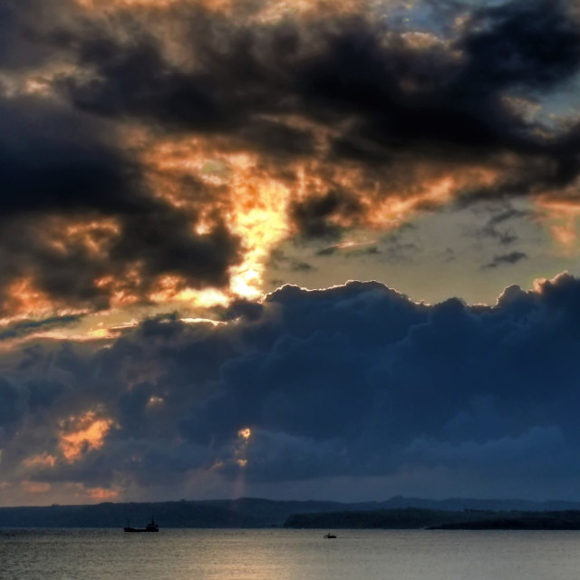 """""""Cloudy sunrise in the bay"""" stock image"""