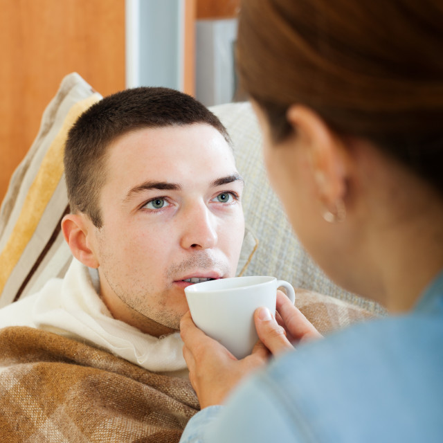 """woman caring for unwell man"" stock image"