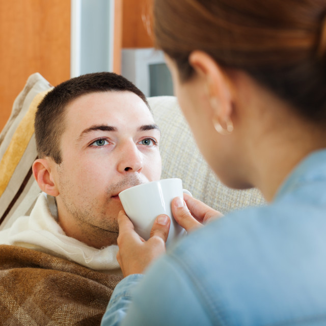 """woman caring for unwell husband"" stock image"