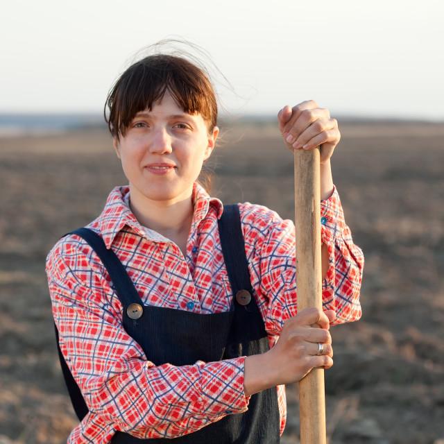 """farmer with spade in plowed field"" stock image"