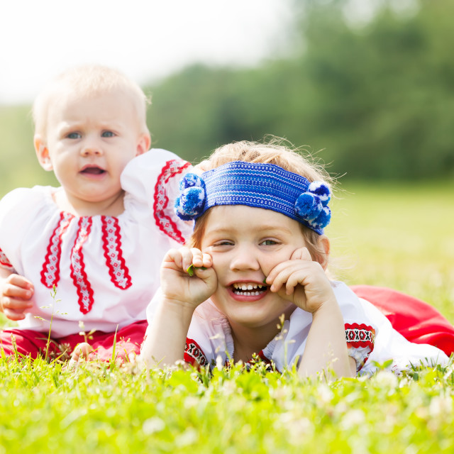 """""""Two children in traditional folk clothes"""" stock image"""