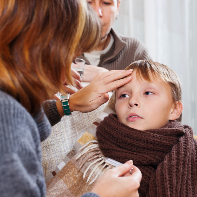 """Parents measuring the temperature of unwell boy"" stock image"