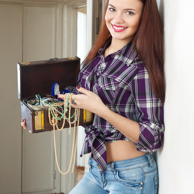 """housewife with treasure chest"" stock image"