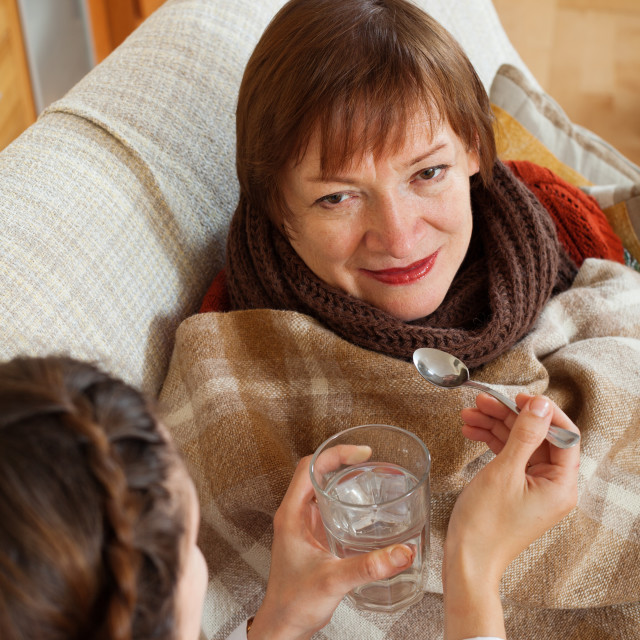 """Nurse caring for unwell mature woman"" stock image"