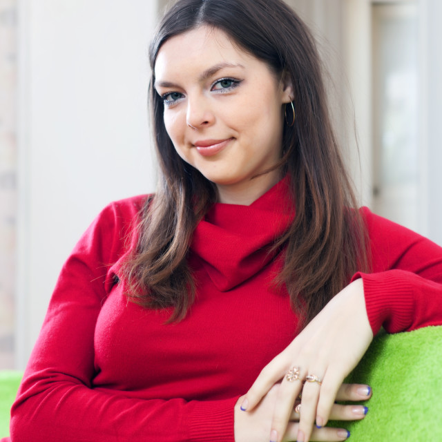 """""""girl in red at home"""" stock image"""