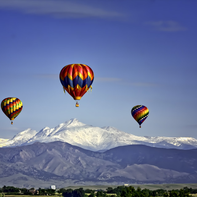 """Colorful Hot Air Balloons Over Mountains"" stock image"
