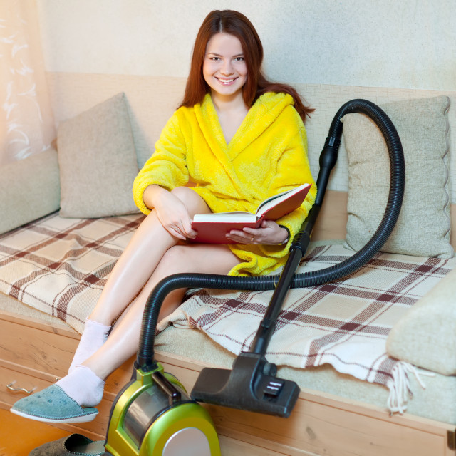 """tired woman reposes from household chores"" stock image"