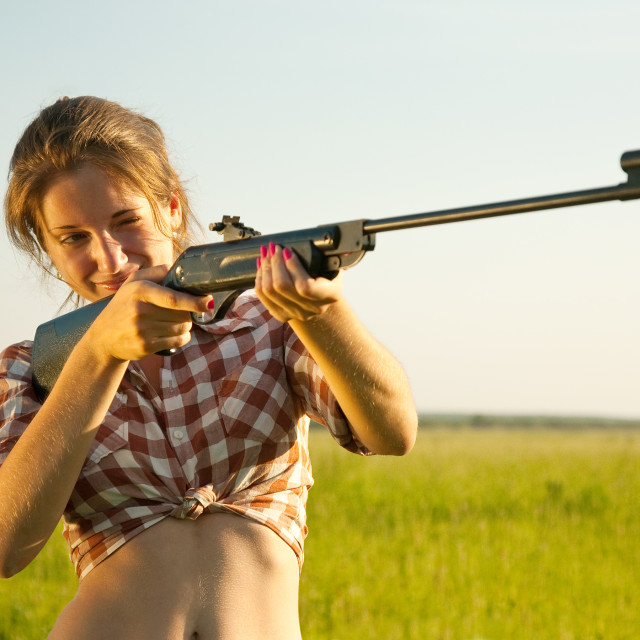 """girl aiming a pneumatic rifle"" stock image"