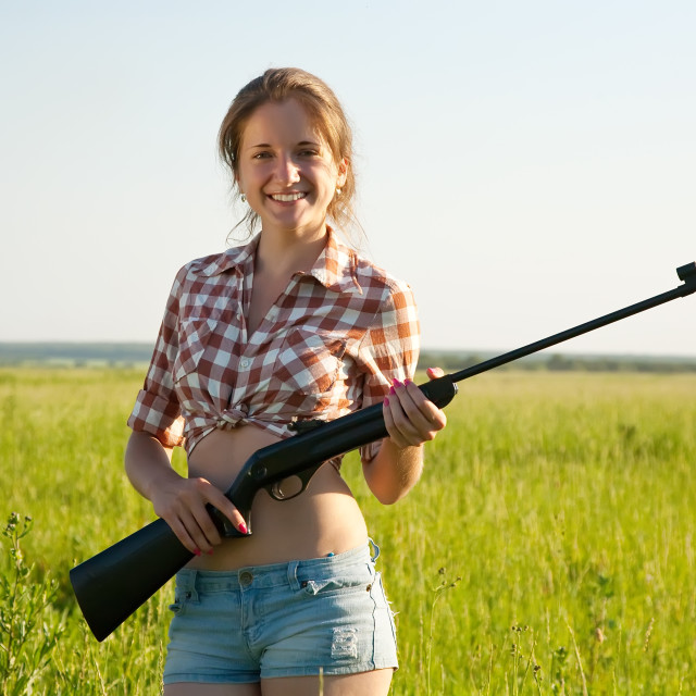 """""""girl holding pneumatic air rifle"""" stock image"""