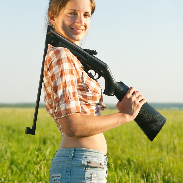 """""""Girl with pneumatic air rifle"""" stock image"""